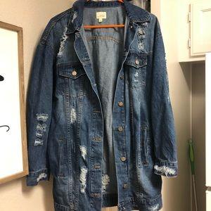 Long oversized destroyed denim jacket